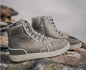 Pair of light grey mens boots.