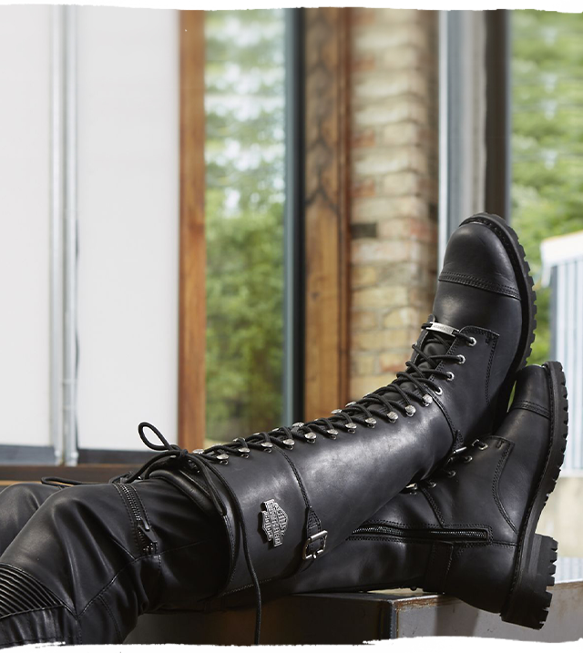 Tall boots on crossed legs.