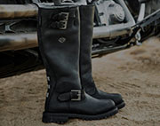 Pair of black womens boots with black soles.